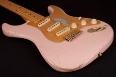 Custom Shop Strat Relic in Shell Pink with distressed gold pickguard.