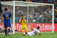 Goal! Mario Gotze of Germany scores his team's first goal past Sergio Romero of Argentina ...