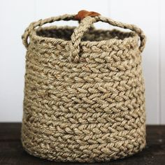 With some simple sewing and a $5 roll of jute, you can make one of these braided baskets!