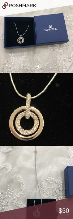 "Swarovski Circle Pendant By Swarovski Exquisite in its elegance, this trendy yet classic pendant is a must-have. The sheen of the rhodium-plated outer ring offsets the glitter of the inner circle that sports clear crystals set in the classic pave style. A hint of shine is always appreciated! This pendant comes on a chain. Measures 16.5"" Never wore this Swarovski Jewelry Necklaces"