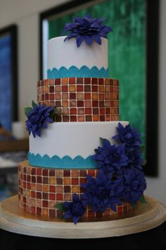 This #weddingcake from the #orlpwgshow is absolutely gorgeous! This mosaic style has definitely been trending into weddings and we love it!