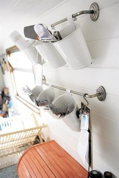 Ikea family: Life on a houseboat - The boat doesn't have much drawer space, so we use these wall-mounted containers to store our cutlery.