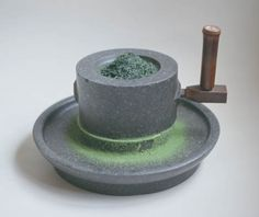 Tea production: Grinding tea in a tea mortar to make matcha.