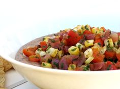 Black Bean Hummus with Roasted Corn Salsa - Traditional hummus move aside! This twist on the healthy dip is made from black beans and topped with a sweet, roasted corn salsa!