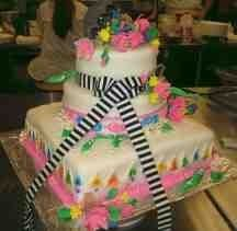 Hmong inspired wedding cake. Diff color flowers to match wedding theme and it would be perfect