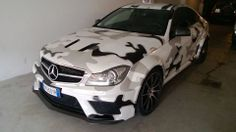 C63 AMG Black Series wrapped in snow camouflage