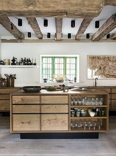 Love this gorgeous rustic Copenhagen kitchen with exposed beams and an unfinished wood kitchen island.