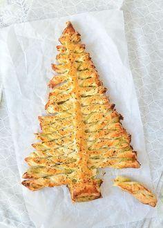 Met deze pesto-bladerdeeg kerstboom steel je de show met de feestdagen. Je maakt dit recept snel en eenvoudig, terwijl het resultaat heerlijk is.