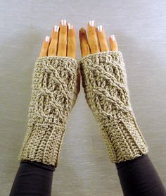 Ravelry: Celtic Cable Fingerless Mittens pattern by Jennifer Ozses C$5.00 CAD about $3.87