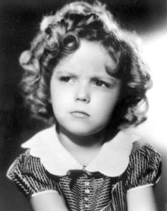 Shirley Temple, 1934; adorable frown on that tiny face!