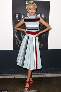 Trendsetter: Zendaya's toned arms looked incredible in her sleeveless polo neck top with blue, grey, red and white horizontal stripes