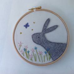 A pretty spring inspired picture.  A gray felt bunny and embroidered flowers all hand sewn onto cream cotton. The bees and butterfly are hand painted using textile paint. Framed in a 6 embroidery hoop and backed with wadding and felt for a quality finish.  This item is ready to ship.