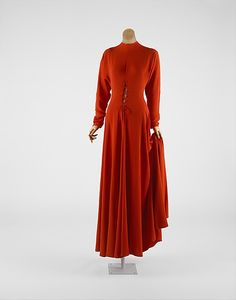 "Circa 1934 silk Evening dress by Valentina, American. Via MMA: ""In the era of exposure of the back, Valentina ingeniously created a covered-up look with a single surprise, an adroit erotic charge at center front. Using slicing and suturing at that spot, Valentina gave drama to a dress that is otherwise monastic."""