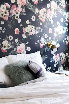 The Midnight Floral wallpaper is a favorite, and for good reason. It adds  beautiful florals as well as mood and drama to any room, accent wall, or  space. This print was crafted/ photographed from fresh spring flowers by  Samantha Santana, and including anemones, ranunculus, and eucalyptus  bra