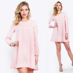 Bubblegum lace up shift Light pink long sleeve shift dress with a lace up detail.  Pair it with fabulous nude heels to complete the look. V-neckline. Lace up detail. Stretch bands at wrists. 100% polyester do not purchase this listing message me to create your own Lewboutiquetwo Dresses Midi