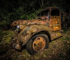 Retired old trucks, vintage trucks abandoned in the forest