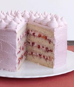 Strawberry Layer Cake-This is a made from scratch 4-layer cake recipe with a delicious strawberry butter cream filling and icing. Makes 12 servings. Perfect for that special holiday or any day.
