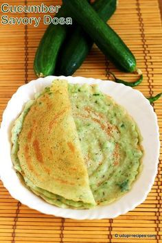 Cumin flavored cucumber savory dosa recipe with step by step pictures.