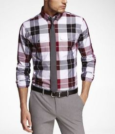 This plaid shirt with gray pants and tie is a great fit for a first date.