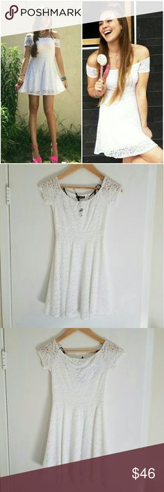 """*HP* NWT LF White Lace TFNC London Dorothee Dress Brand new w/ tags. White lace overlay off-shoulder dress. Rose design.  Nylon/Poly/Viscose/Elastine. Pull-on fit. Darts at bust. Retailed for $156 at LF. By TFNC London. Sz M UK = US S. Approx length from middle of neckline to hem is 28"""". Popular dress. Several UK fashion bloggers' pick!  Please check out my closet for more NWT LF items to bundle w/ discount & 1 shipping fee. LF Dresses Mini"""