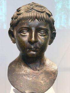 Bronze portrait bust of a young boy Roman Julio-Claudian 50-68 CE. Photographed at the Metropolitan Museum of Art in New York City, New York.
