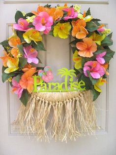 This fun Hawaiian Luau Wreath started with a straw base and we filled it with orange, pink and yellow hibiscus blossoms for a full, lush look. Description from etsy.com. I searched for this on bing.com/images