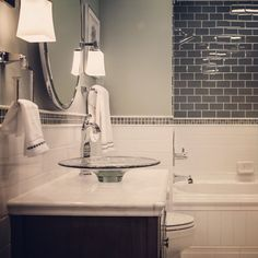 Ceramic and Glass subway tile in the bathroom - our master bath will have this - different color scheme Hall Bathroom, Laundry In Bathroom, Bathroom Renos, Remodel Bathroom, Bathroom Tile Designs, Bathroom Ideas, The Tile Shop, Glass Subway Tile, House Tiles