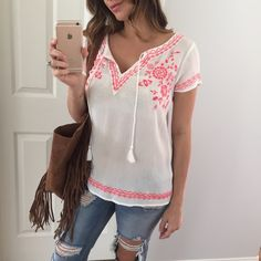 """Bright Pink & White Boho Top • Item Information: Such a GORGEOUS top! Perfect for some sunny weather. Pink & white boho style top with a tassel feature. Looks like an anthropologie top. 100% rayon- slightly sheer. Does not stretch. *Price is firm*  • Modeling: Small  • Measures: S: 25.5"""" long 18.5"""" chest  • Sizes available: S & M   • Use the """"Buy It Now"""" feature or request your size to make a bundle Tops Tees - Short Sleeve"""