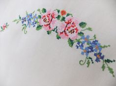 Vintage embroidered tablecloth - cream with cross stitch flowers in pink, reds and blue