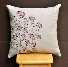 Red Ixora Throw Pillow Cover 18 x18, Embroidered Decorative Pillow, Red Brown Floral on Light Dessert Sand Linen Pillow, Pillow Accent. $23.00, via Etsy.