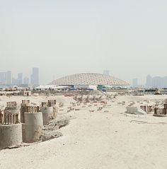 The Louvre Abu Dhabi dome and the site of the Guggenheim's troubled project.