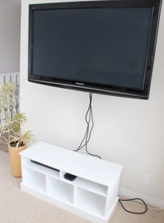 Hide wire clutter using an affordable plastic shower rod cover avail. at hardware or home improvement stores. Easy and affordable solution to messy wires! Hiding Tv Cords On Wall, Hide Tv Wires, Hide Tv Cables, Hiding Wires Mounted Tv, Tv On Wall, Hiding Cables, Shower Rod, Shower Curtain Rods, Cacher Cable Tv