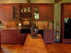 Rustic Red Kitchen Cabinets barn red kitchen cabinets | kitchen with barn red cabinets, brass