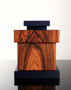 Ettore Sottsass    Plywood box , birch plywood structure covered with three layers of rosewood. Knob and base of small-leafed lime wood. Blue aniline colouring and wax finish.    Produced in a limited edition of 99 by Serafino Zani | Numa    Signed and numbered
