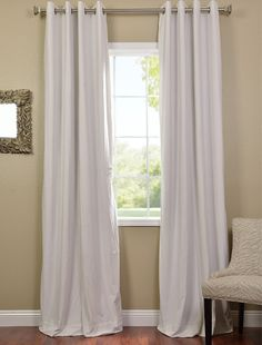 This is the first time I have seen white blackout curtains. A must when your bedroom faces southwest.