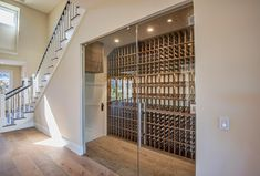 Under staircase wine cellar Stair Storage, Wine Storage, Caves, Wine Cellar Basement, Home Wine Cellars, Malibu Homes, Wine Display, Wine Cabinets, Under Stairs