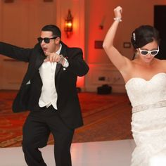 Rachel and Peter. Rachel and Peter start the party wearing white and black sunglasses upon entering the reception. Image Credit: Carrie Wildes Photography.