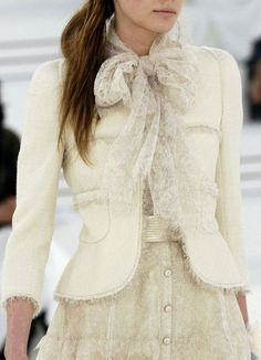 A tie blouse or scarf are eternally elegant. Chanel