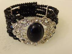 Crystal bead bracelet with big diamante devider