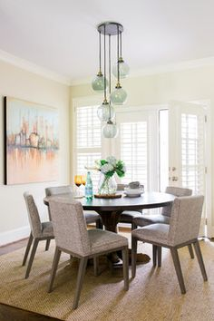 Dining Room With Fun Lighting Jute Rug Round Wood Table Gray Chairs
