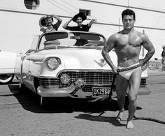 Jack Lalanne pulling a car full of women