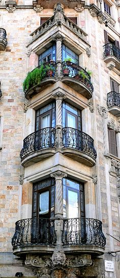 Balcones de Barcelona  I must live in the one with the plants! lol I wish.