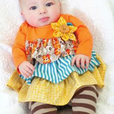 Molly&Milie Orange/Blue/Yellow/Brown Outfit from Freckles Children's Boutique for $53.00