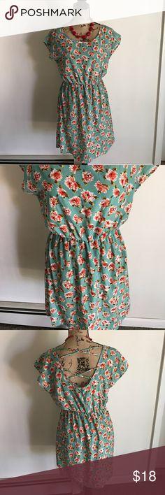 Beautifulsummer dress size Large Junior Beautiful floral summer dress never worn. This dress features a caged back. Never worn size Large juniors Dresses Mini