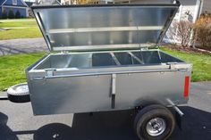 Nice looking trailer for a solar panel, a bunch of batteries, and some camping gear.