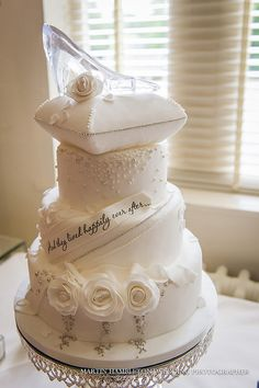 Disney themed wedding cake with glass slipper. Omg so cute!!