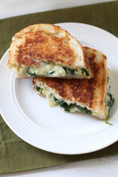 spinach artichoke grilled cheese by annieseats - Annie says I need this in my life and by looking at it, I definitely agree.
