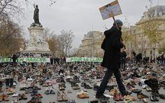Thousands of shoes are laid out in Paris' Place de la République after a   climate change protest is cancelled due to security reasons ahead of   Monday's international climate negotiations