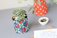 upcycled can to fabric flower vases - these would make sure great gifts with a little plant or flowers inside