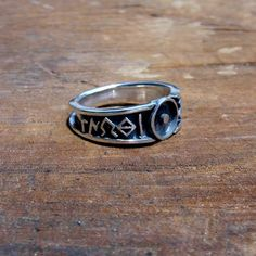 """The Monad Ring At the center of the ring appears the symbol of Monad – a circle with a point in the center. Around the ring engraved in archaic Greek the only commandment for the one who is truly awake  – """"Know thyself""""."""